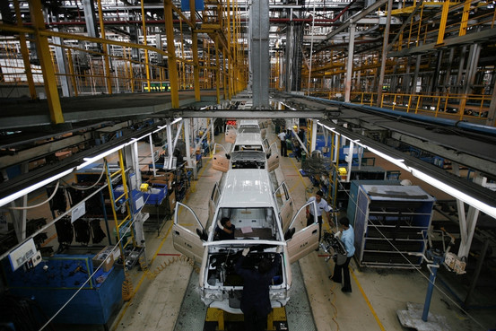 Workers assembling-Chevrolet Tavera SUVs
